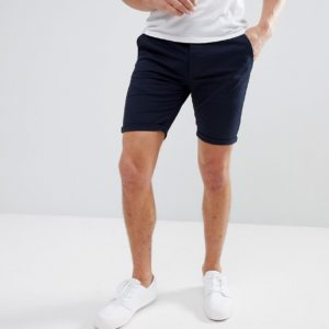 Comprar Pantalones cortos chinos ajustados en azul marino de ASOS DESIGN