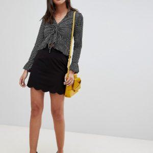 Comprar Minifalda de sastre acampanada con bajo festoneado de ASOS DESIGN