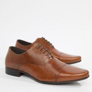 Comprar Zapatos Oxford de cuero tostado con detalle de puntera de ASOS DESIGN
