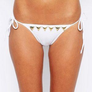 Comprar Braguitas de bikini con lazos laterales y adorno de triángulos dorados de ASOS DESIGN