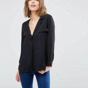 Comprar Blusa sencilla estilo pijama con detalle de bolsillos de ASOS