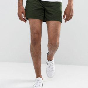Comprar Pantalones cortos chinos slim elásticos en verde oscuro de ASOS