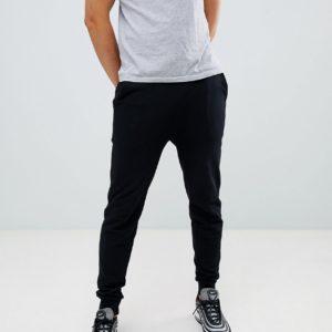 Comprar Joggers ajustados en negro de ASOS DESIGN