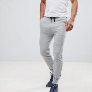 Comprar Joggers ajustados en gris marga de ASOS DESIGN