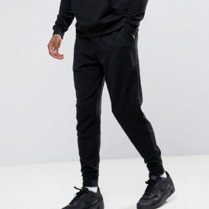 Comprar Joggers de corte slim en negro de ASOS DESIGN