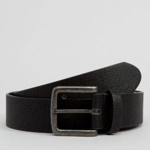 Comprar Cinturón ancho de efecto cuero en negro de ASOS DESIGN