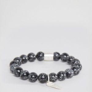 Comprar Pulsera negra con cuentas y colgante de alas plateadas de Chained & Able